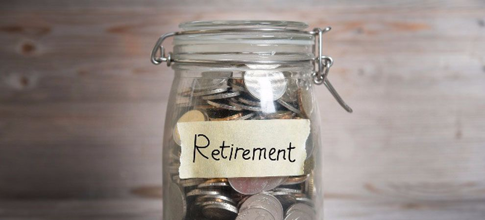 Money in a glass jar labelled 'Retirement'